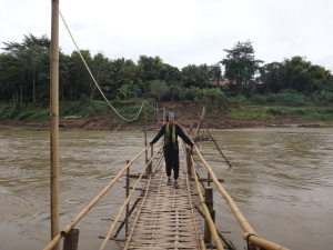 Jo 'owning' the bamboo bridge across the Mekong