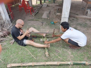 Sawing bamboo is a two man job!