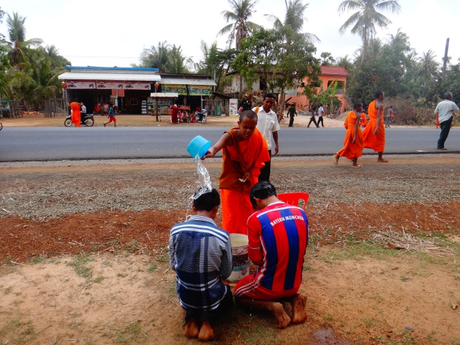 The monks are coming and they're blessing the new road....As well as those who wish to be blessed!